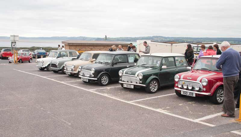 Variety of Minis in car park including a convertible